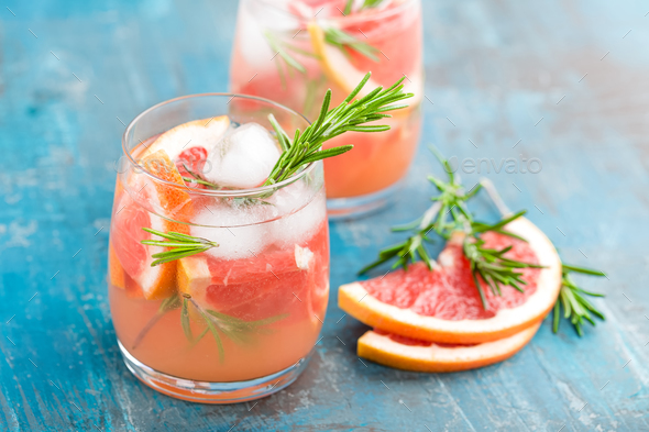 Grapefruit and rosemary gin cocktail, refreshing drink with ice - Stock Photo - Images
