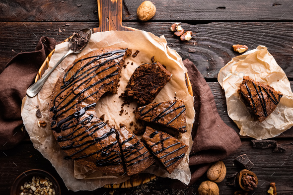 Chocolate brownie cake, dessert with nuts on dark background, top view - Stock Photo - Images