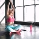 Full Length Portrait of Attractive Young Woman Working Out in Luxury Fitness Center, Doing Yoga or