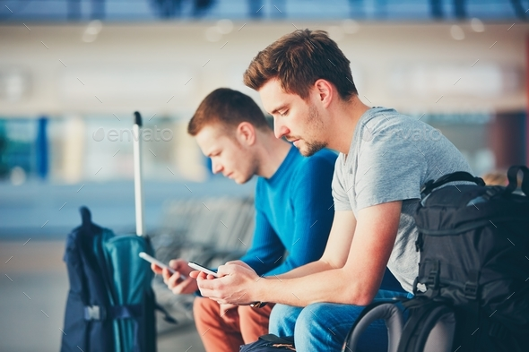 Travelers waiting for departure - Stock Photo - Images