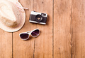 Summer vacation composition. Sunglasses, camera, hat. Studio sho