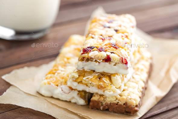 Delicious granola bars with oat, honey and yogurt, healthy food for breakfast - Stock Photo - Images