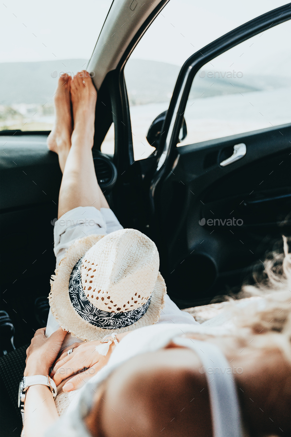Girl having a rest in a car - Stock Photo - Images