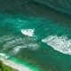 Aerial View of Waves Rolling One By One To the Nunggalan Beach Near Uluwatu, Bali, Indonesia - VideoHive Item for Sale