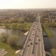 Aerial Shot of Cars Passing Over the Bridge through the River. Golden Ring Tour - VideoHive Item for Sale