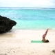 Girl on the Beach Practicing Yoga - VideoHive Item for Sale