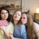 Three Young Female Best Friend Have Fun and Make Selfie on Mobile, Grimacing and Laughing