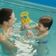 Cheery Mother with Her Funny Baby Laughing in the Pool - VideoHive Item for Sale