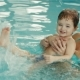 Mother with Her Baby Have Fun in the Pool - VideoHive Item for Sale