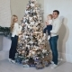 Young Happy Family with a Child Dressing Up a Christmas Tree - VideoHive Item for Sale