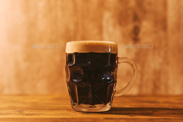 dark craft beer in british dimpled glass pint mug stock photo bydark craft beer in british dimpled glass pint mug stock photo images