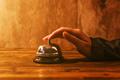 Businesswoman ringing hotel reception bell - PhotoDune Item for Sale
