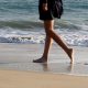 Girl Walking in The Ocean Beach - VideoHive Item for Sale