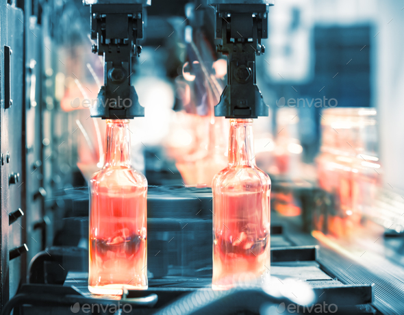Hot glass bottles on the conveyor - Stock Photo - Images