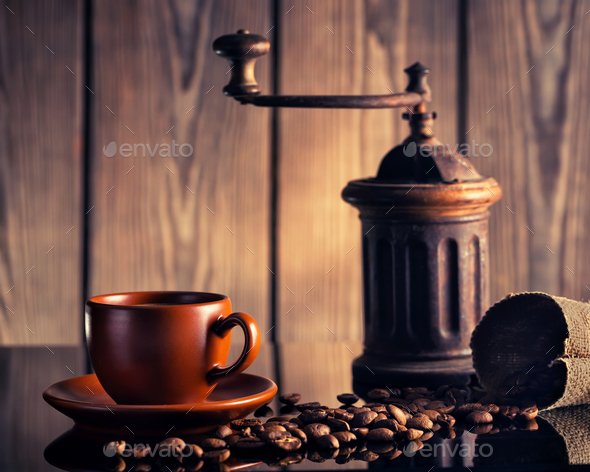 Coffee still life with an old coffee grinder - Stock Photo - Images