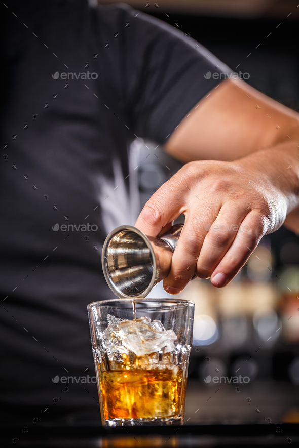 Bartender pouring alcohol - Stock Photo - Images