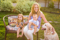 Mother and her children Relaxing In Garden With Pet Dog - PhotoDune Item for Sale