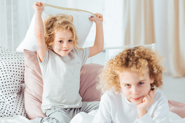 Boy annoying his older brother - Stock Photo - Images