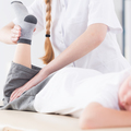 Physiotherapist exercising patient's leg - PhotoDune Item for Sale