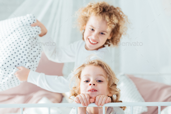Boy annoying his younger brother - Stock Photo - Images