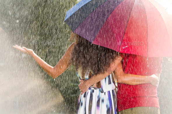 Man and woman under umbrella - Stock Photo - Images