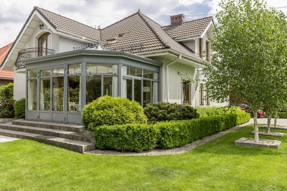 Modern house with glazed arbor - Stock Photo - Images