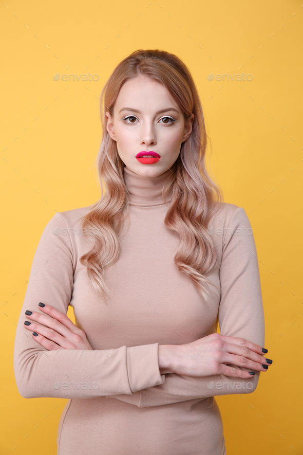 Concentrated young blonde lady with bright makeup lips - Stock Photo - Images