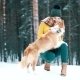 Beautiful Girl with Her Dog in the Winter Wood