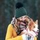 Beautiful Girl Petting Her Dog in the Winter Wood