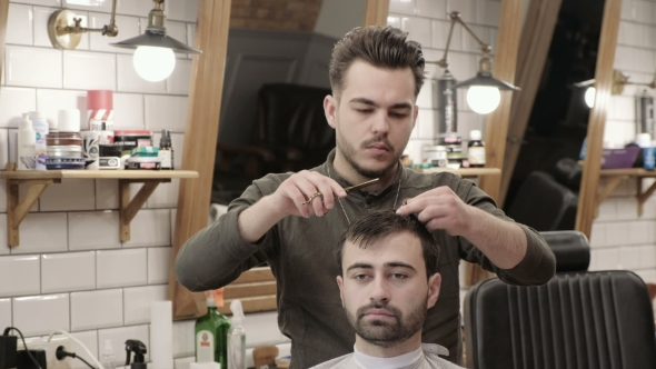 VideoHive Man Hairdresser Doing Haircut Beard Adult Men in the Men's Hair Salon Haircut with Scissors 19919231