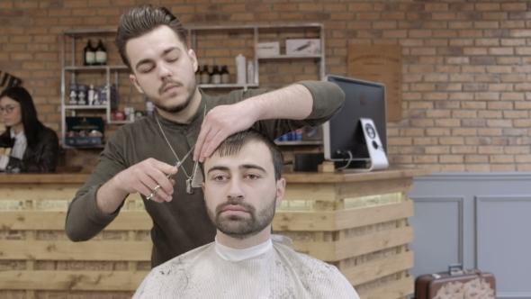 VideoHive Man Hairdresser Doing Haircut Beard Adult Men in the Men's Hair Salon Haircut with Scissors 19919241