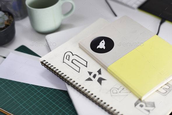 Notebook With Brand Logo Creative Design Ideas - Stock Photo - Images