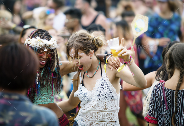 Group of Friends Drinking Beers Enjoying Music Festival Together - Stock Photo - Images