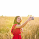 woman taking selfie by smartphone on cereal field - PhotoDune Item for Sale