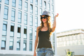 stylish hipster woman walking on the street - PhotoDune Item for Sale