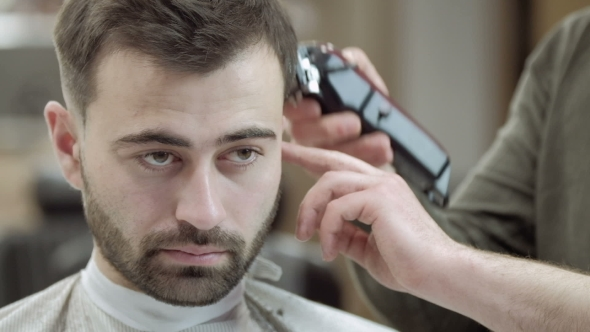 VideoHive Master Cuts Hair and Beard of Men in the Barbershop Hairdresser Makes Hairstyle for a Young Man 19922932
