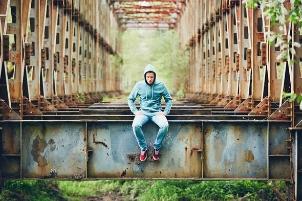 Sad man on the abandoned bridge - Stock Photo - Images