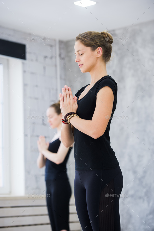 Two women in gym class, relaxation exercise or yoga class - Stock Photo - Images
