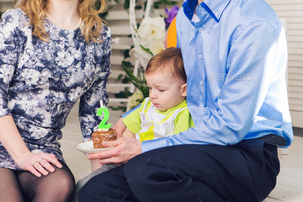 Child, birthday party and childhood concept - Little boy with a birthday cake - Stock Photo - Images