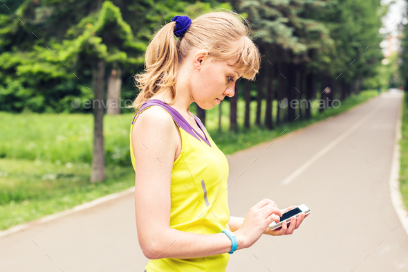 Woman checking fitness and health tracking wearable device - Stock Photo - Images