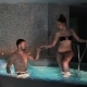 Couple on a Date at the Beautiful Swimming Pool in the Sauna - VideoHive Item for Sale