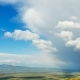 TimeLaps. Lush Clouds Move Rapidly Over the Spring Fields and Villages, the Top View in Spring - VideoHive Item for Sale