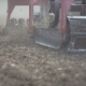 Tractor Harrowing Brown Field
