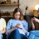 Three Young Girl Have Addiction of Telephone Mobile and Online Life
