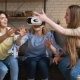 Three Young Female Friends Have Fun Together Using VR Device Actively - VideoHive Item for Sale