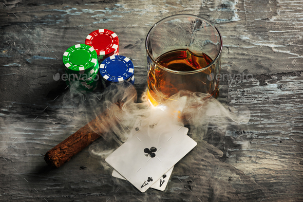 Cigar, chips for gamblings, drink and playing cards - Stock Photo - Images
