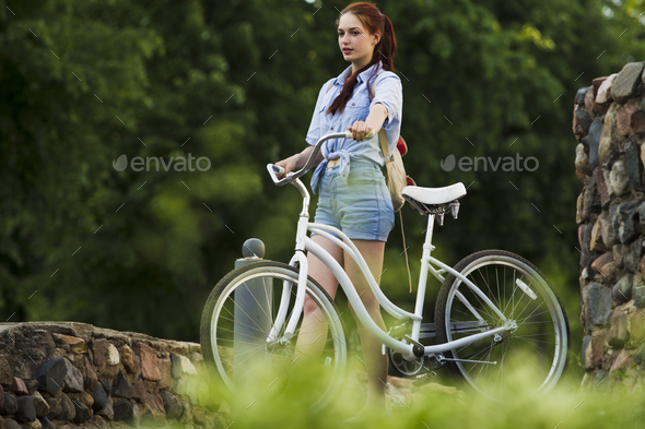 Girl and white bike - Stock Photo - Images