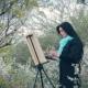 Beautiful Girl Draws on Nature