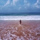 Girl Running To the Ocean