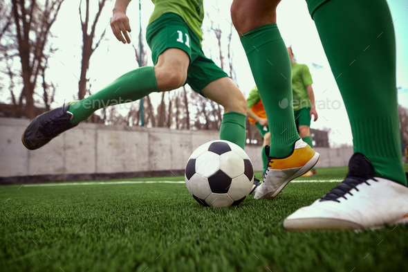 Thq legs of soccer football player - Stock Photo - Images